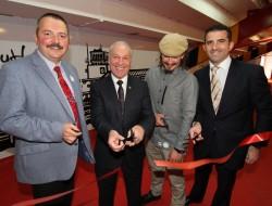 Photograph by Hattie Miles ... 19.04.2016 ... Artist Miroslav Lucan with his work under the 'away stand' at AFC Bournemouth's Vitality Stadium ... Jeff Mostyn, chairman of AFC Bournemouth, cuts the ribbon to mark the official opening of the newly decorated away stand area. l-r, Stefan Kraus, Coastal BID manager, Jeff Mostyn, artist Miroslav Lucan and Paul Clarke, Coastal BID chairman.